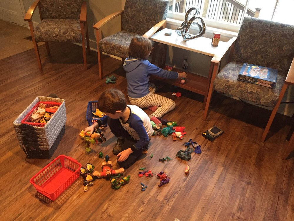 Organizing toys in the waiting room.
