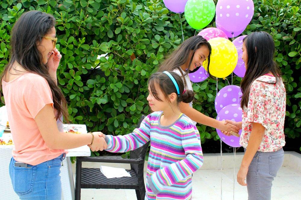Students practicing etiquette lessons taught by Monique Graciotti of VERITAS Institute