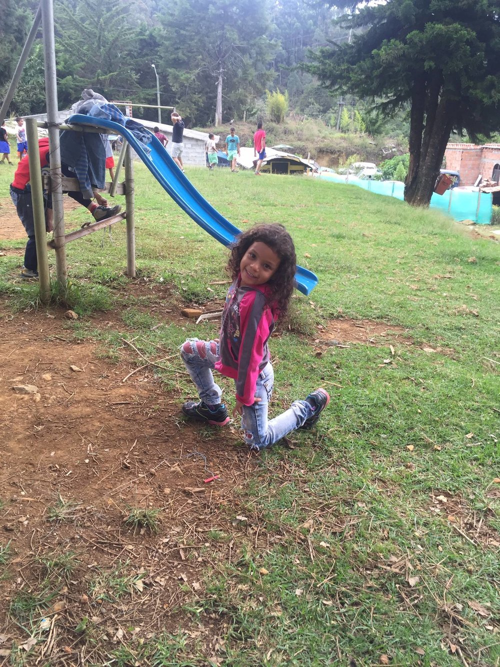 Girl at the orphanage playing in her new shoes
