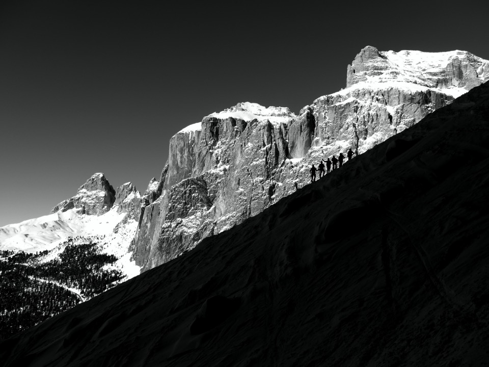 The picture was taken on their trip in 2014 to Wolkenstein / South Tyrol in the Dolomites. They hired a guide and skied down Val Lasties and Val Mezdi. The picture was taken by the guide Simon Kehrer