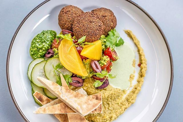 Let your taste buds take an exotic trip for lunch with our Falafel Mezze Plate with a side of creamy hummus 😋  #Noshington