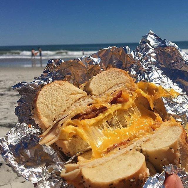 The holy trinity of summer: beaches, bikinis, and bagels 👙☀️🏖 • #BetterAtBeachBagels #BeachBagels #Bagels #Beach #WrightsvilleBeach #CarolinaBeach #Wheresthebagelemoji #Wilmington