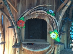 Sculptural stained glass flowers decorating the Enchanted Fairy House.