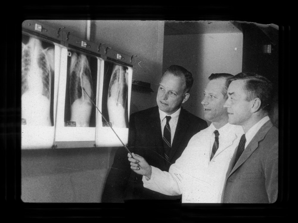 The cardiac clinic was the first pediatric subspecialty clinic at Texas Children's Hospital. From left, Dr. Denton A. Cooley (first chief of cardiovascular surgery), Dr. Edward B. Singleton (pediatric radiologist and first physician on staff) and Dr. Dan G. McNamara (first pediatric cardiologist in Houston) examine the X-rays of one of the first patients in the clinic.