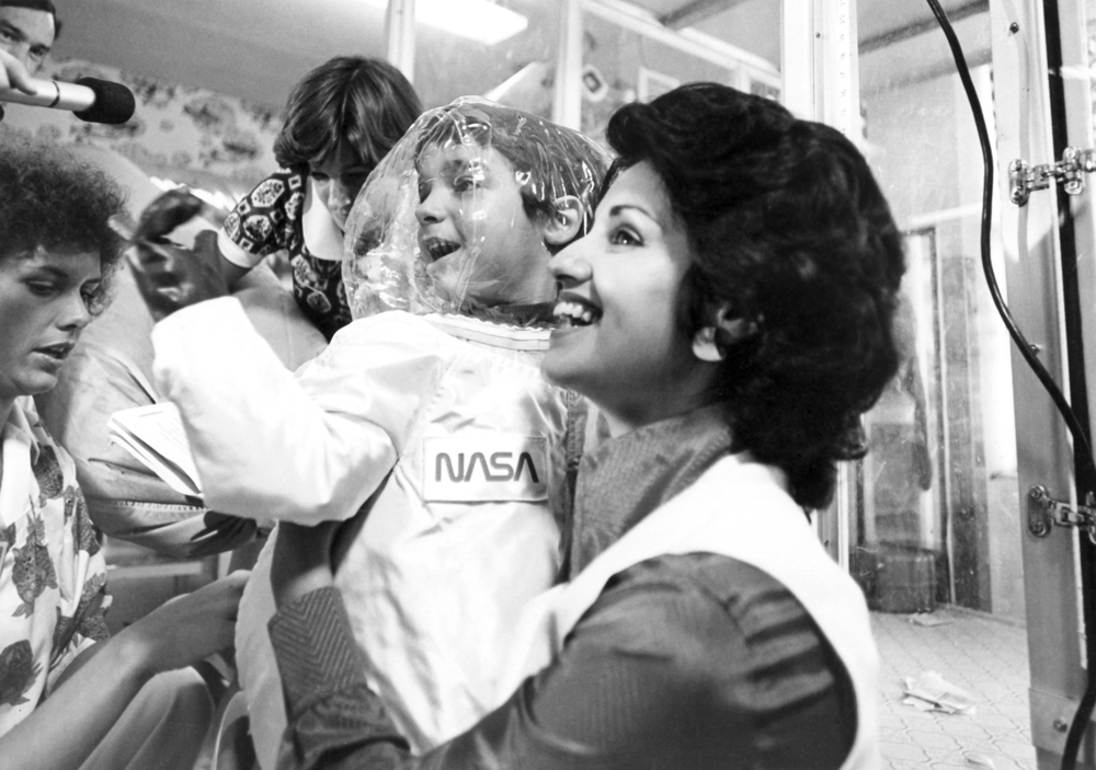 Carol Ann Demaret holds her son, 6-year-old Texas Children's patient, David Vetter, prior to his first walk in a spacesuit in 1977. Vetter had Severe Combined Immunodeficiency, which required him to live in a plastic bubble to protect him from harmful bacteria.