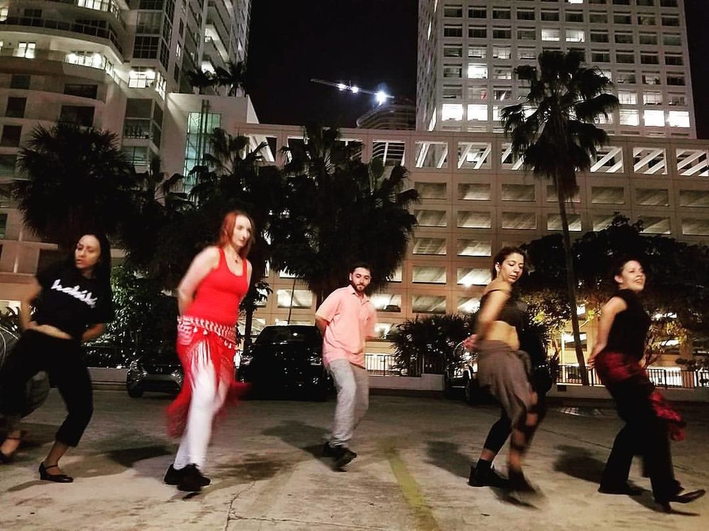 Bonding with these talented dancers was memorable!! Rehearsing in the parking lot! Thank you Anne, for this great shot!