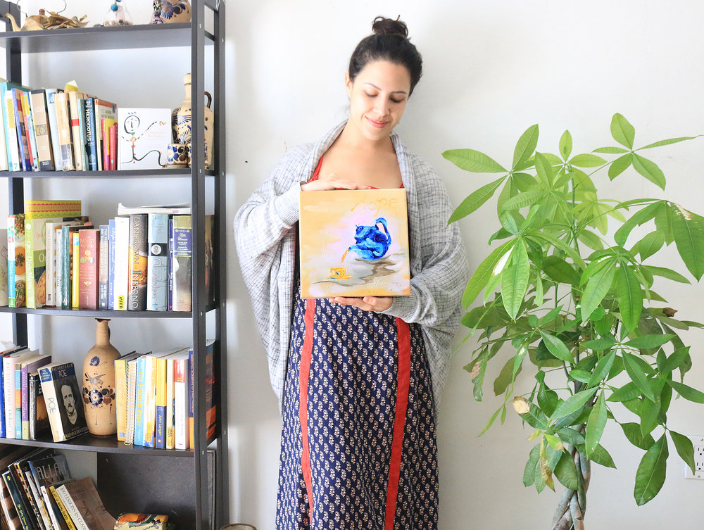 artist with tea pot painting