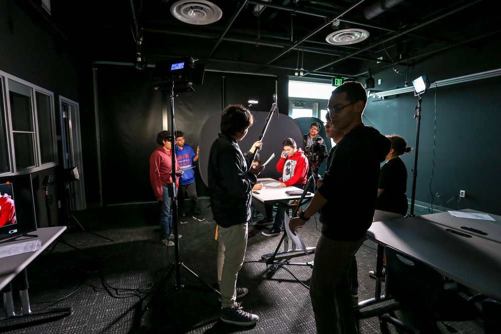 Students film a scene coverage project on the first day in their new studio.
