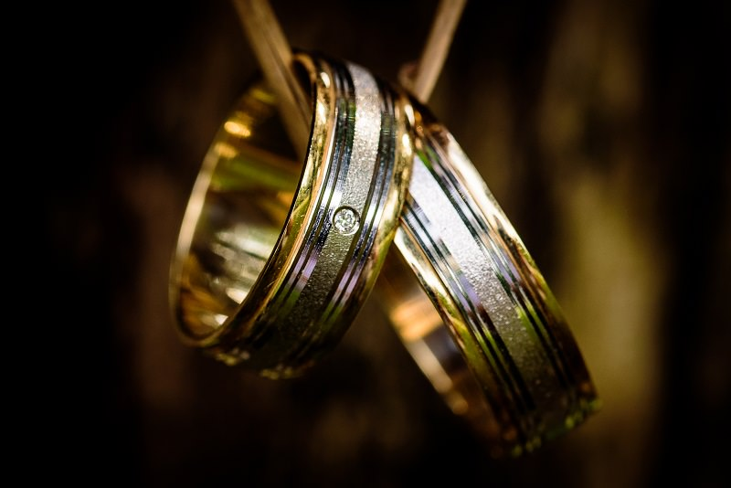 Two 14K weddings bands featuring different gold alloy colors and finishes combined in one piece.