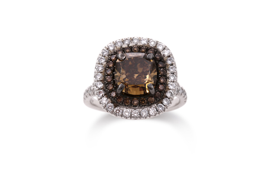 Large cushion cut brown diamond mounted in white gold halo ring.