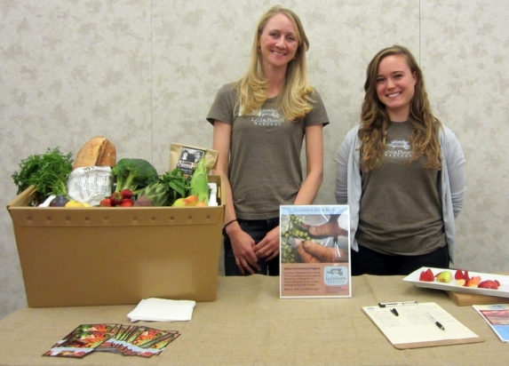 My teammate Alyssa and me, exhibiting LolaBee's at a nutrition event at the Katherine Delmar Burke's School in 2012
