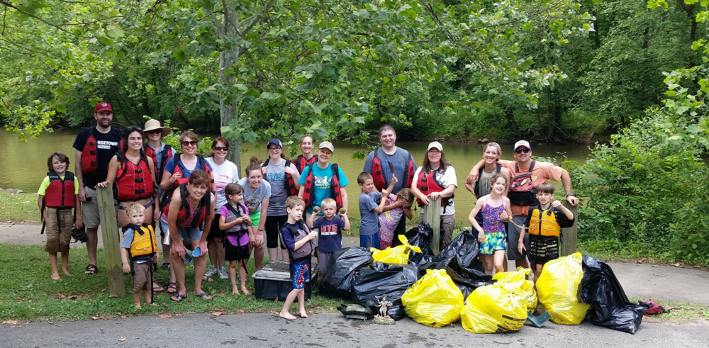 Some of the Earth Stewardship East crew and their haul from June 25 trash cleanup of the Potomac.