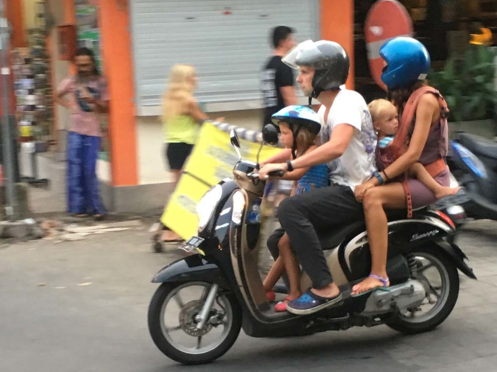 Entire families use one motor bike to get around bali.  no car seats here!