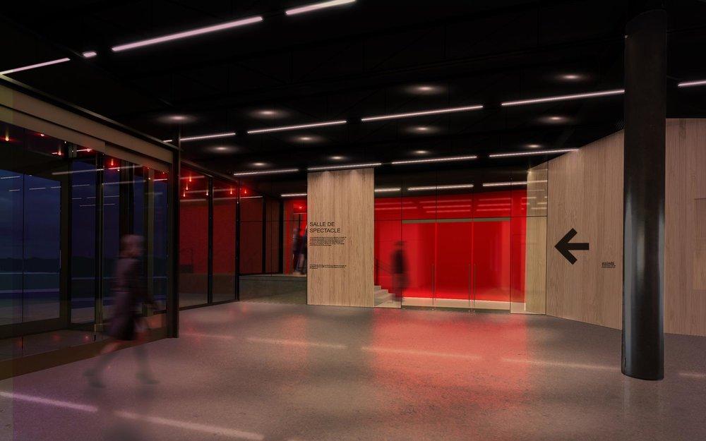Le foyer multifonctionnel partagé avec les étudiants donne accès à la salle par des portes vitrées