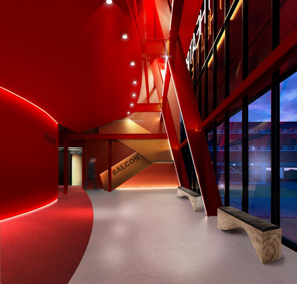 Le nouveau foyer offre une zone de circulation pour distribuer le public autour de la salle avec vue sur l'extérieur