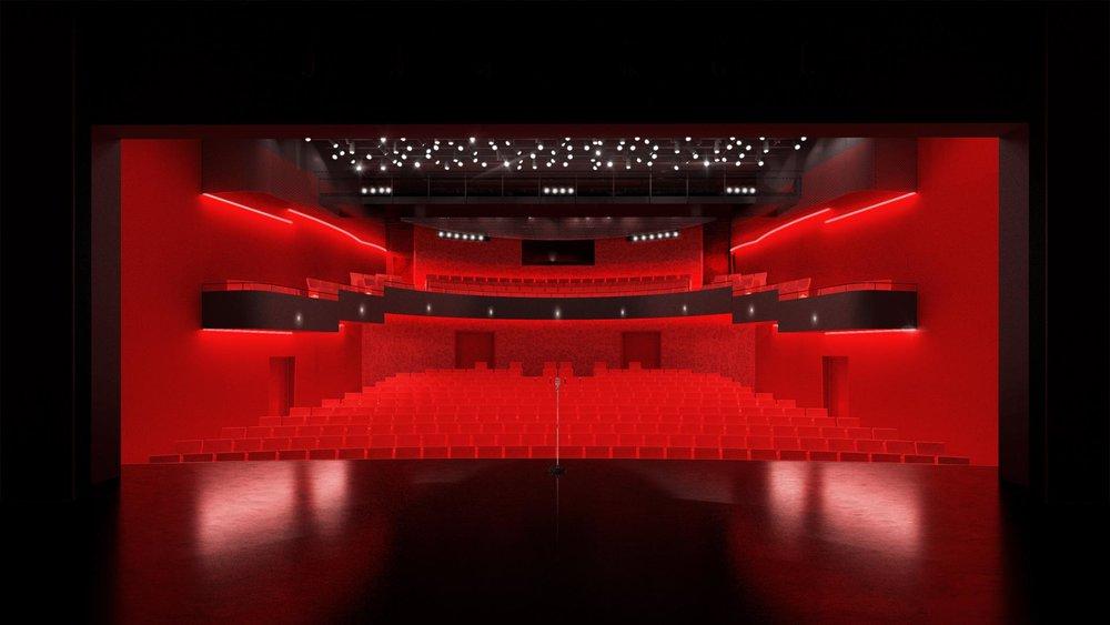 La salle vue de la scène crée un volume enveloppant rouge et noir