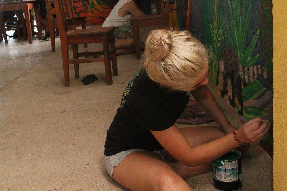 Artist Cassie Larson adding finishing touches