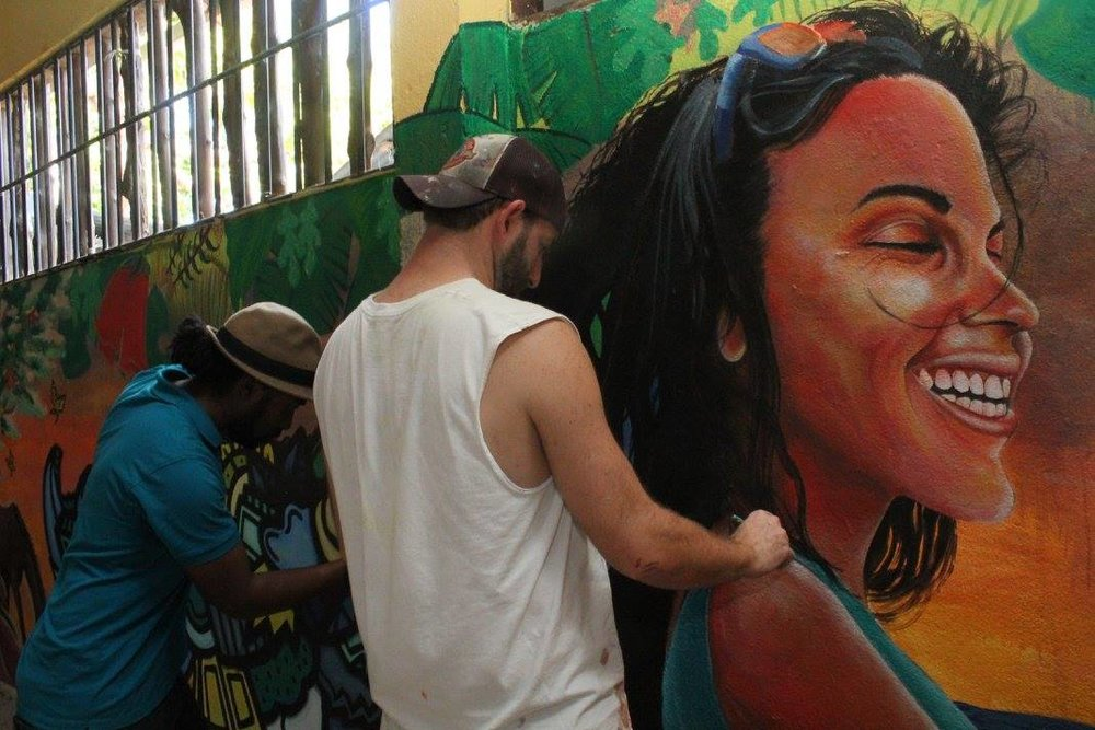 Artists Alloyius McIlwaine (left) and Curtis Glover (right) at work