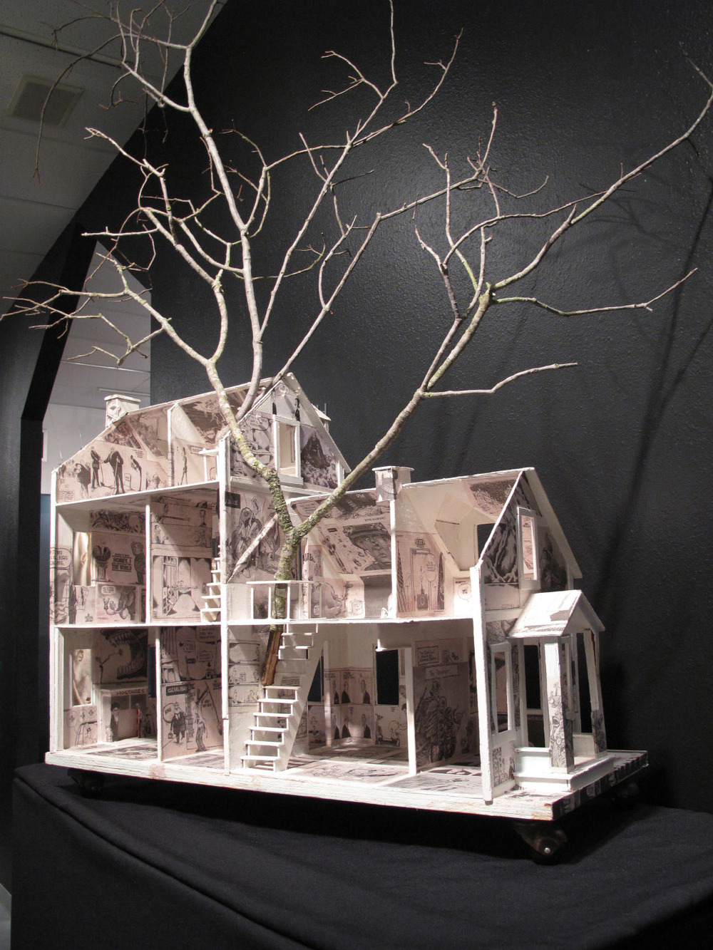 2am(0)-White House, gesso, newspaper collage on wood, tree branch, 35x65.5 x 15 in. 2006.jpg