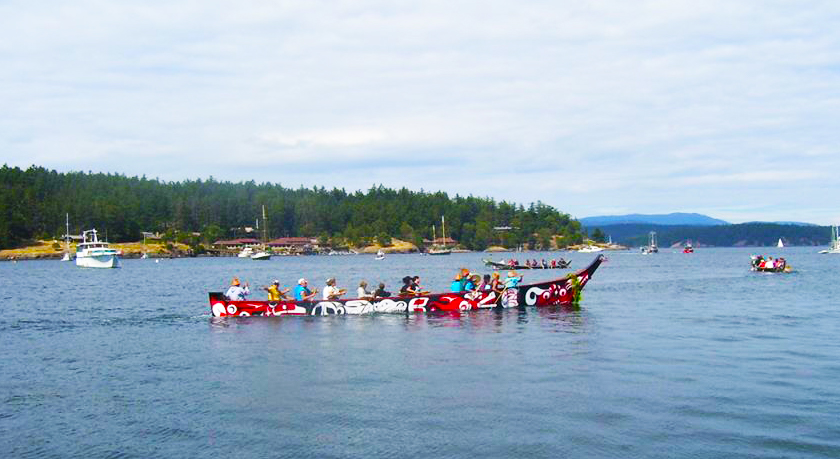 Tribal canoes arriving on San Juan Island.