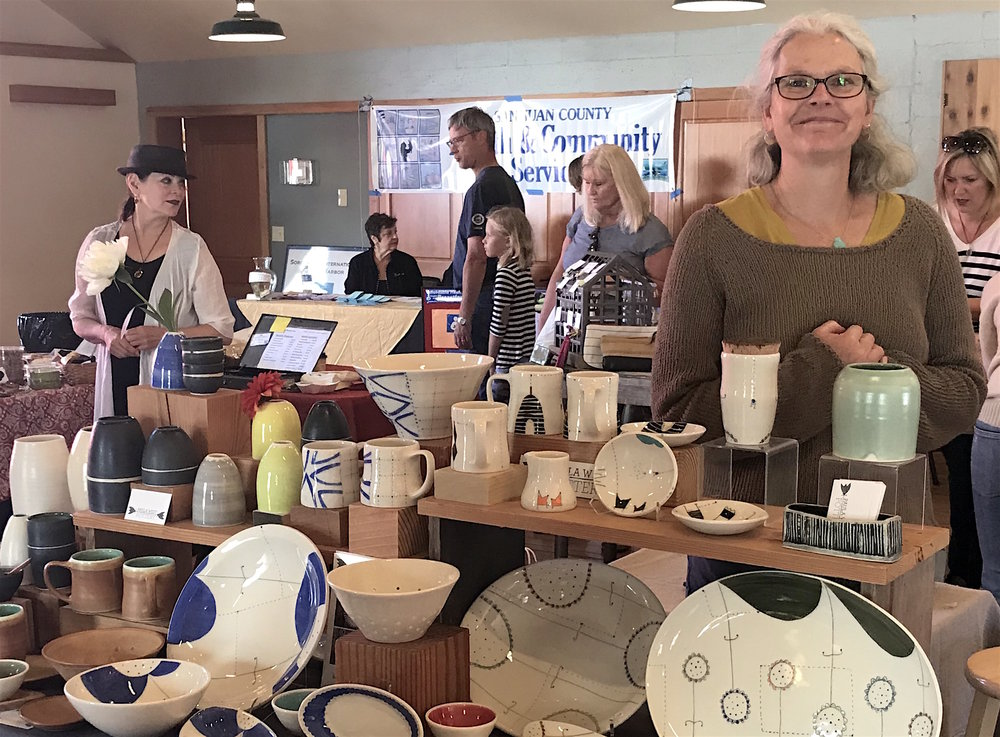 Paula West and her whimsical pottery at the Saturday Farmer's Market