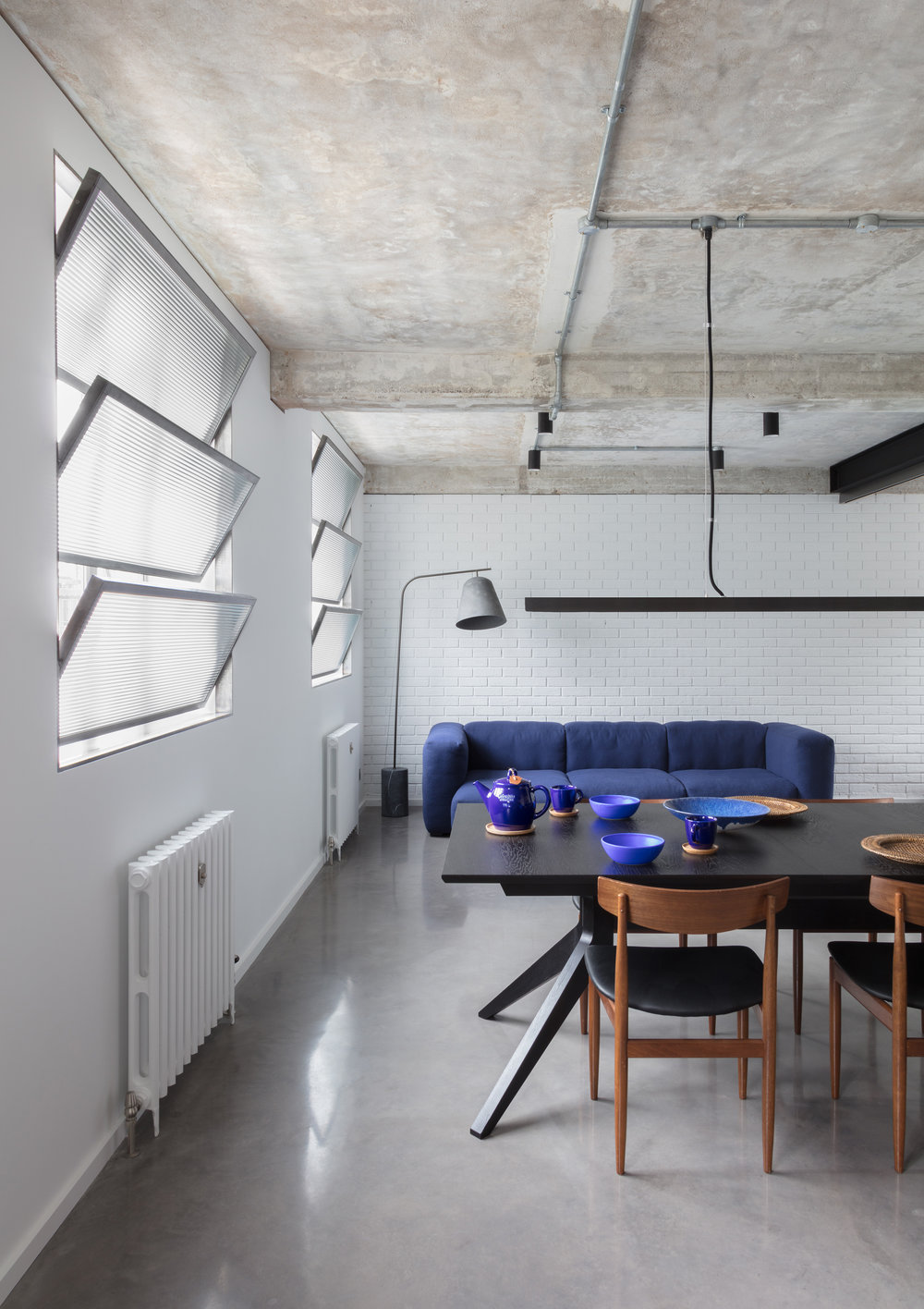 Union-Wharf-Islington-London-Exposed-Concrete-Ceiling-Shutters-Dining-Hay-Sofa-Interior.jpg