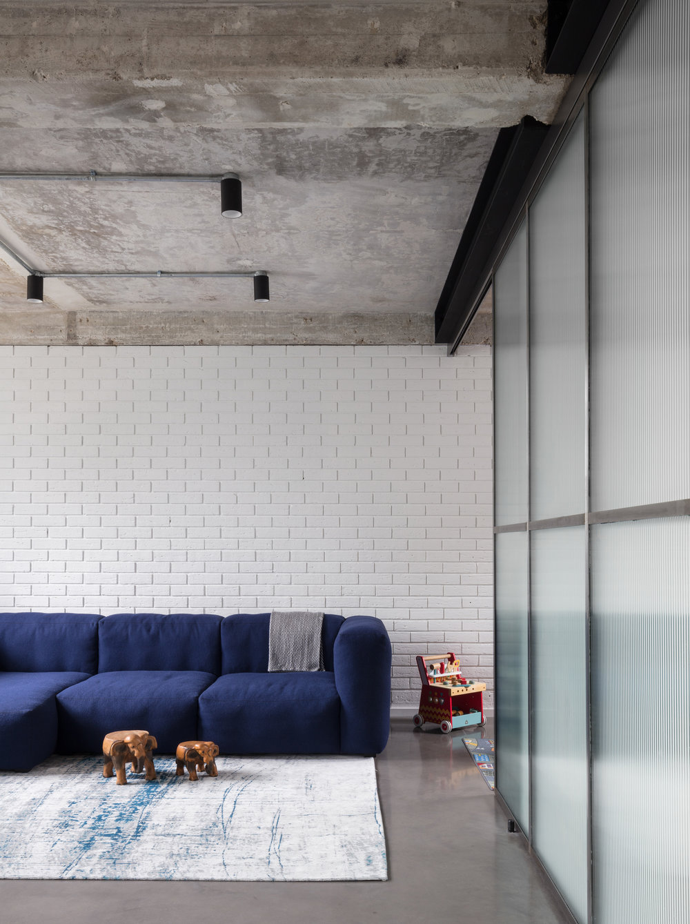 Union-Wharf-Islington-London-Exposed-Concrete-Ceiling-Floor-Hay-Sofa-Interior-Architect.jpg