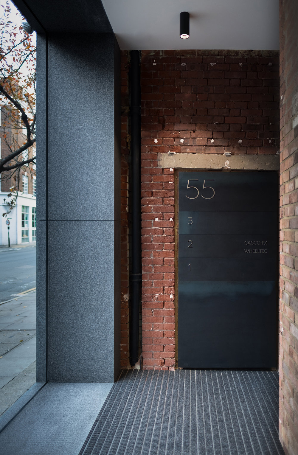 Goswell-Road-Clerkenwell-London-Office-Lobby-Entrance-Exposed-Brick-Metal-Signage-Interior.jpg