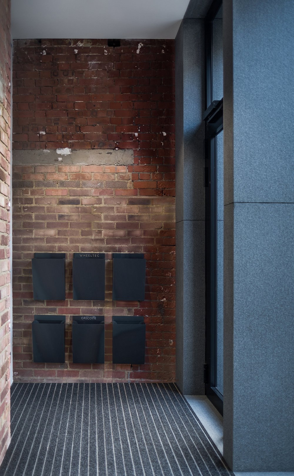 Goswell-Road-Clerkenwell-London-Office-Lobby-Entrance-Exposed-Brick-Metal-Post-Boxes-Design.jpg