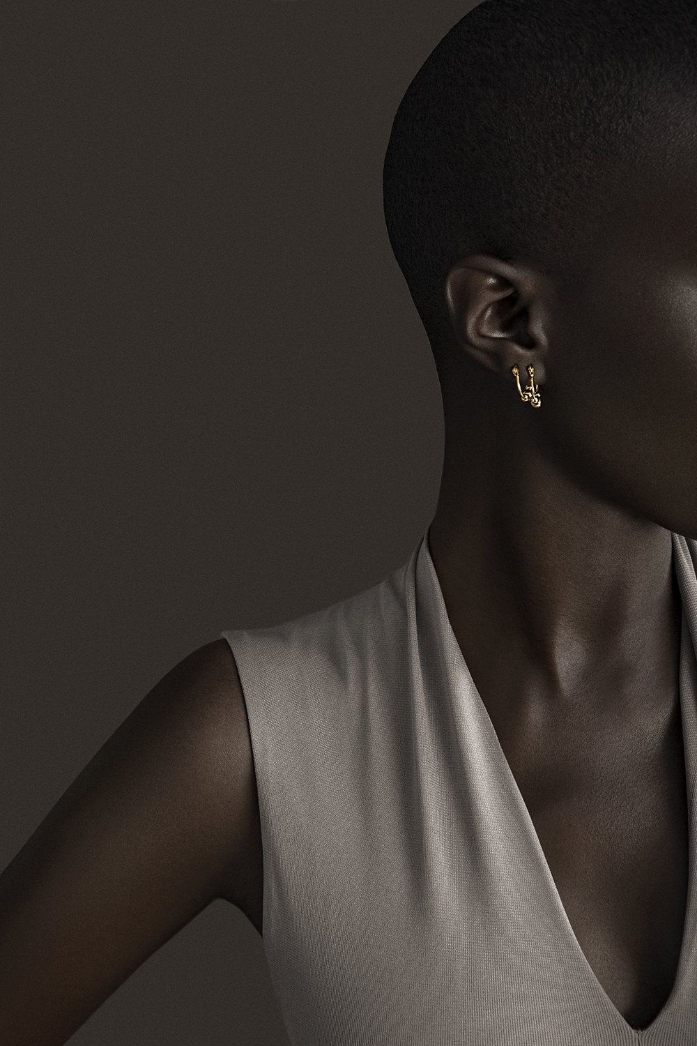 Giannina oteto for nashira arno fashion jewerly nyc based  latin american designer from dominican republic  modern sculptural statement gold ball sphere small hoops.jpg