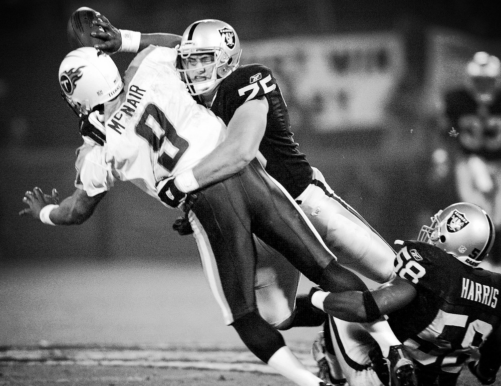 Oakland Raider Chris Cooper sacks Steve Mcnair, AFC championship game
