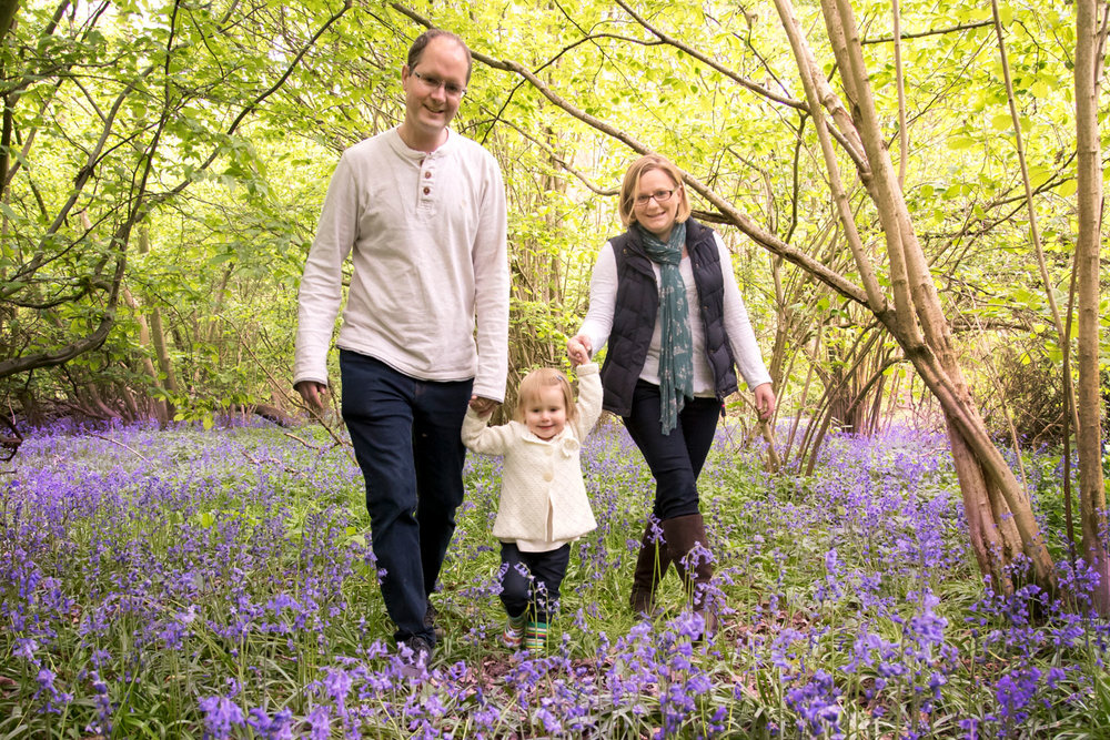 Family_photography_Ely_Cambridgeshire-family-with-1-year-old-walking-through-bluebell-wood.jpg