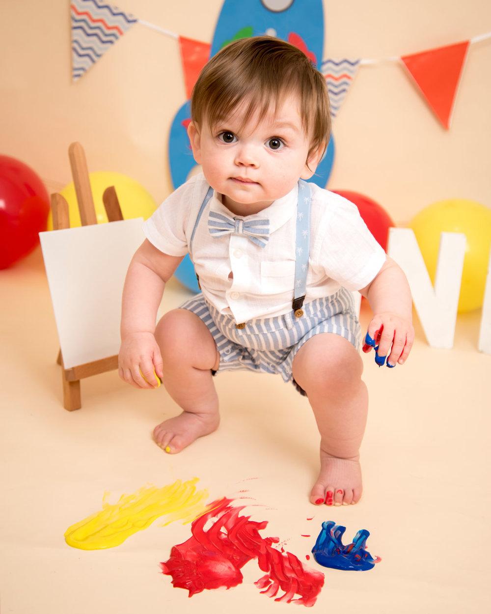 Baby_cake_smash_photography_Ely_Cambridgeshire_paint_splash_cake_smash_alternative_messy_play_first_birthday_for_milo (2).jpg