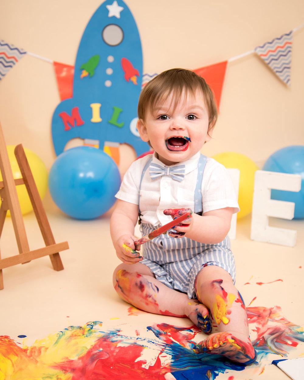 Baby_cake_smash_photography_Ely_Cambridgeshire_paint_splash_cake_smash_alternative_messy_play_first_birthday_for_milo (3).jpg