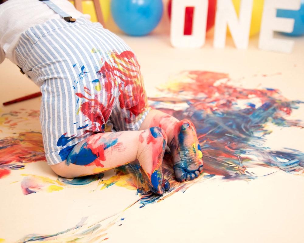 Baby_cake_smash_photography_Ely_Cambridgeshire_paint_splash_cake_smash_alternative_messy_play_first_birthday_for_milo (4).jpg