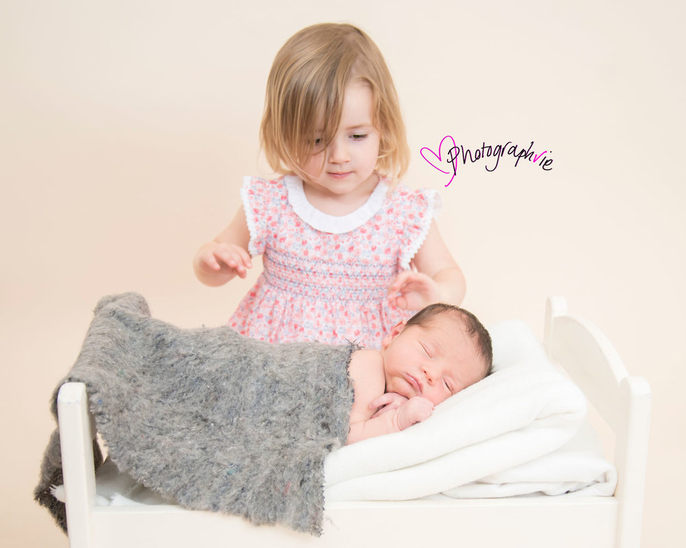 Newborn_Baby_photography_Ely_Cambridgeshire-baby-finley-with-sister-on-bed.jpg
