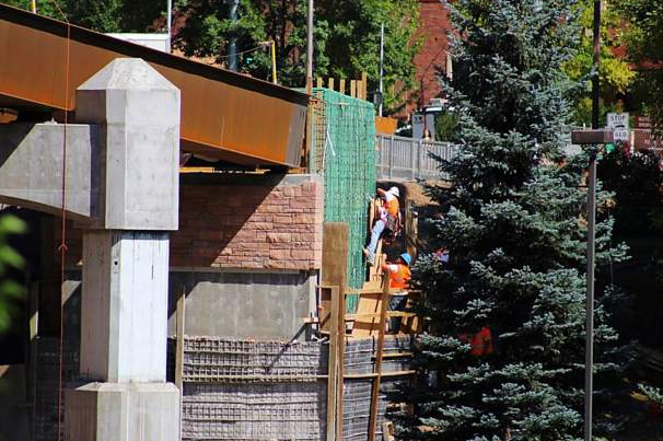 Decorative rock is being installed on the new Glenwood Springs pedestrian bridge.