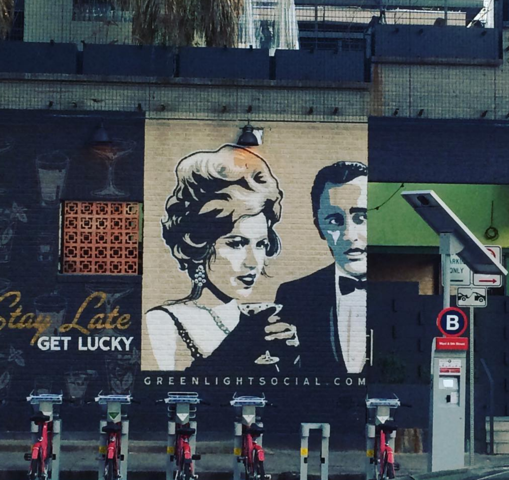 Mural on the side of the Green Light Social in Austin.