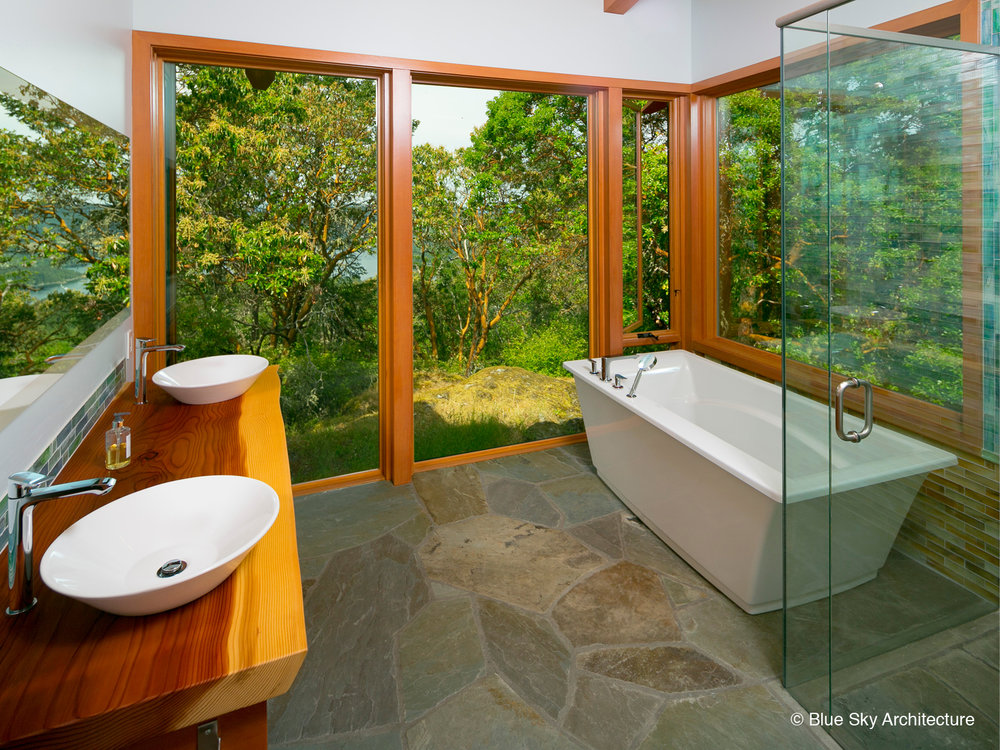 Douglas fir and tile bathroom with frameless glass shower
