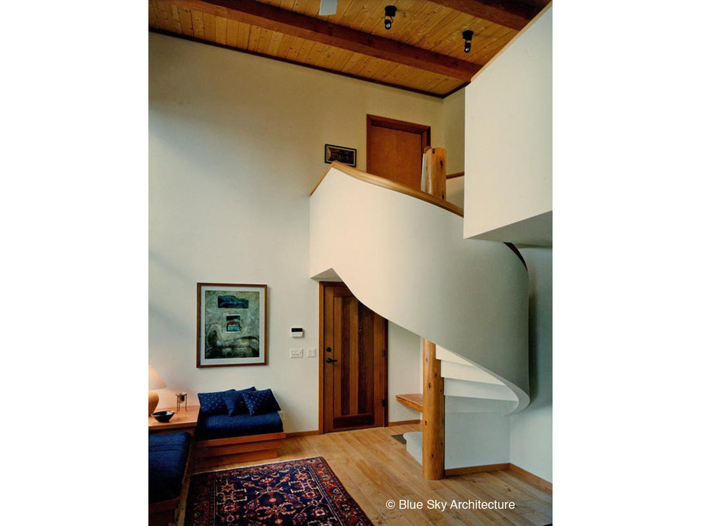 Living Room with Post and Beam and Spiral Staircase