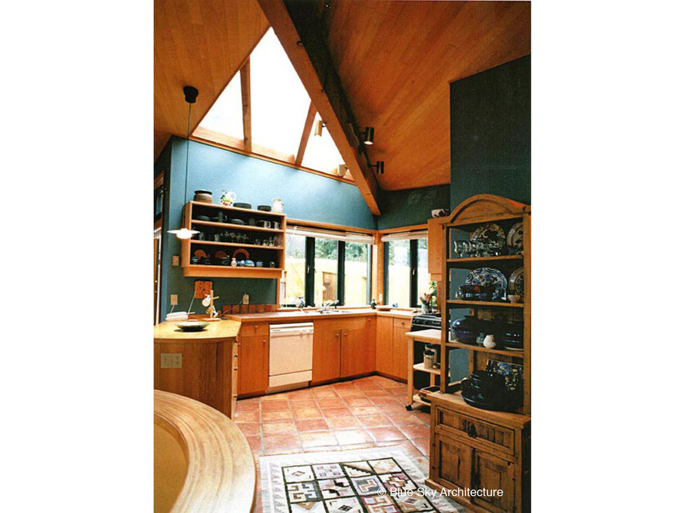 Kitchen with Fir Ceiling and Skylight