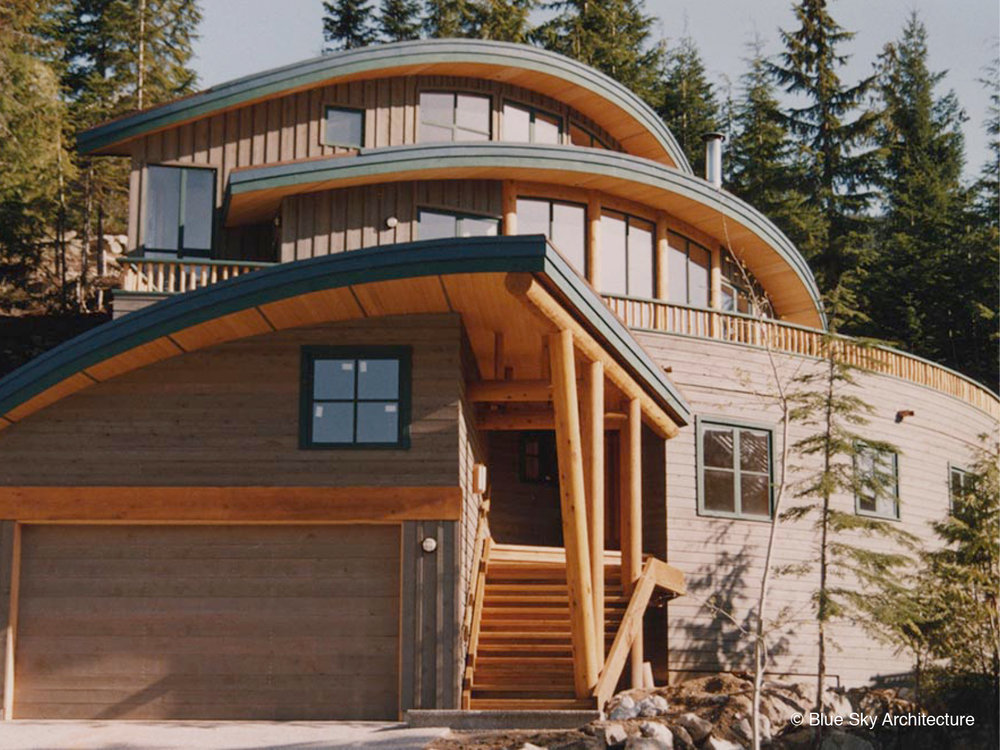 Residence with Radial Design and Natural Materials