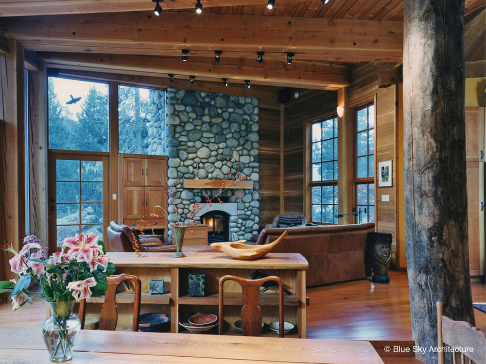 Living Room Design with Stone Fireplace and Heavy Timber Framing