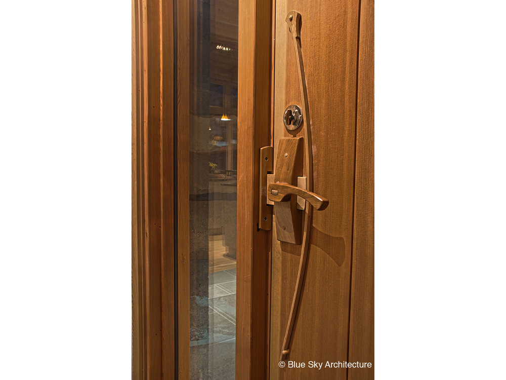 Custom door construction in Naramata Bench House