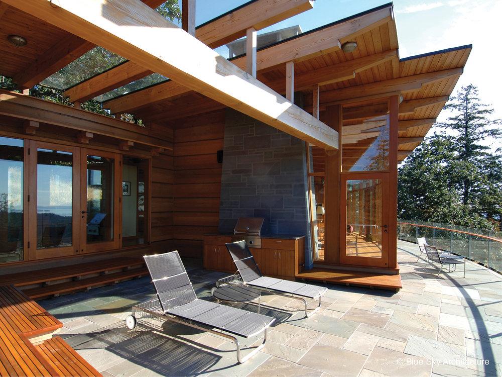 Oak Grove House outdoor living terrace with bluestone tile and cedar walls