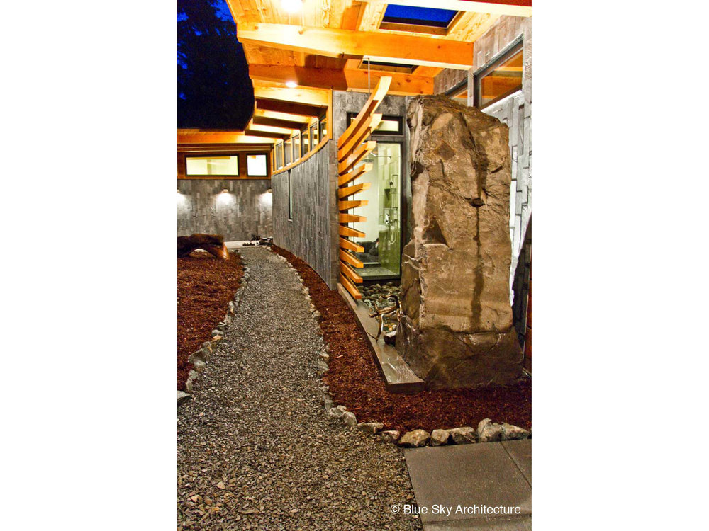 Stone detailing with a water feature on the entranceway to Ucluelet House