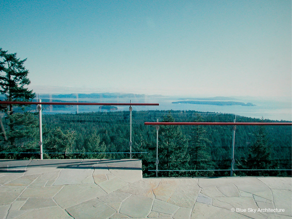 Glass railing and slab terrace of the Hill House