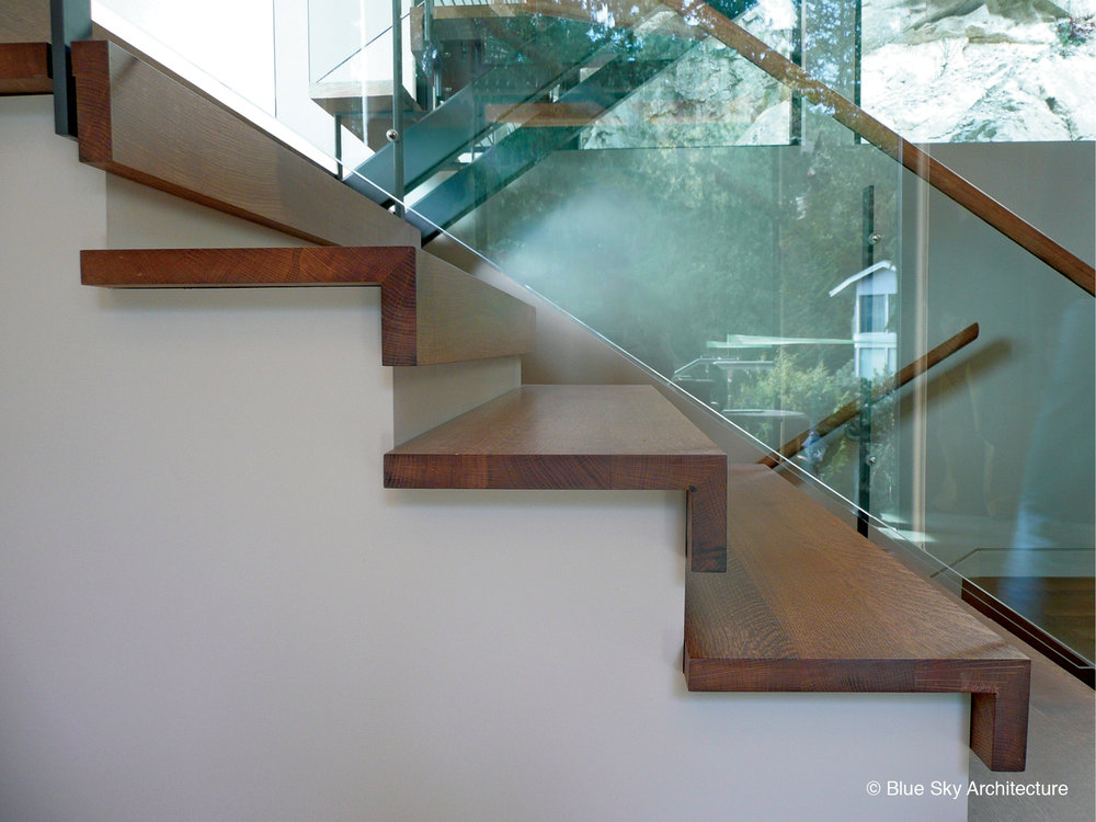Glass and wood stair detail in Harbour House