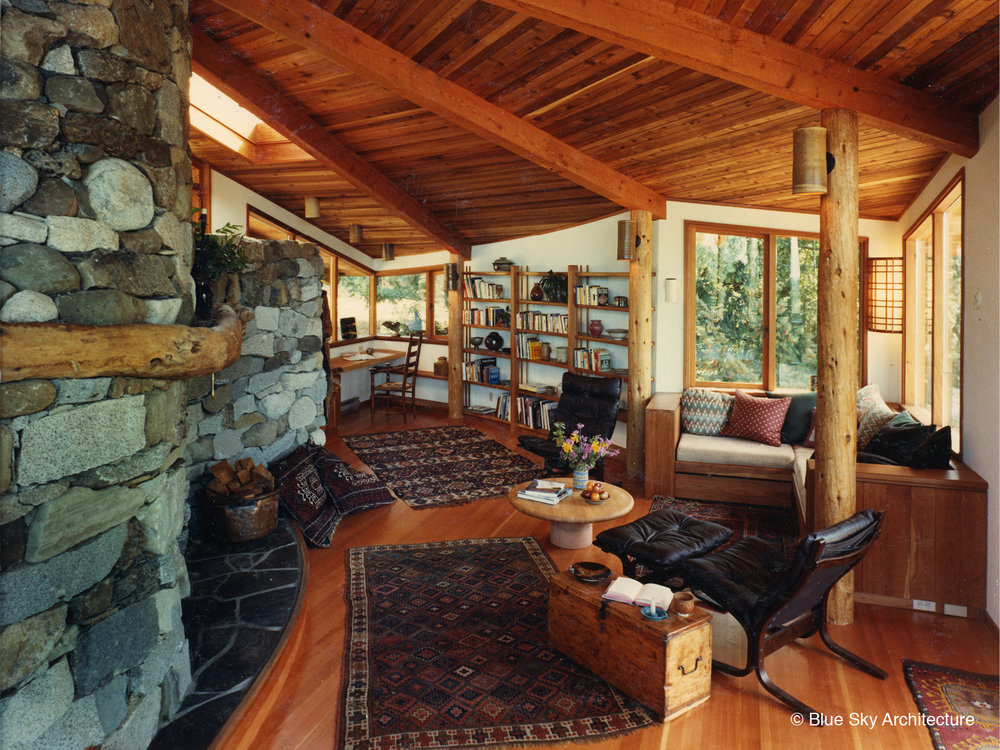 Heavy Timber Ceiling with Natural Log Columns and Radial Rafters
