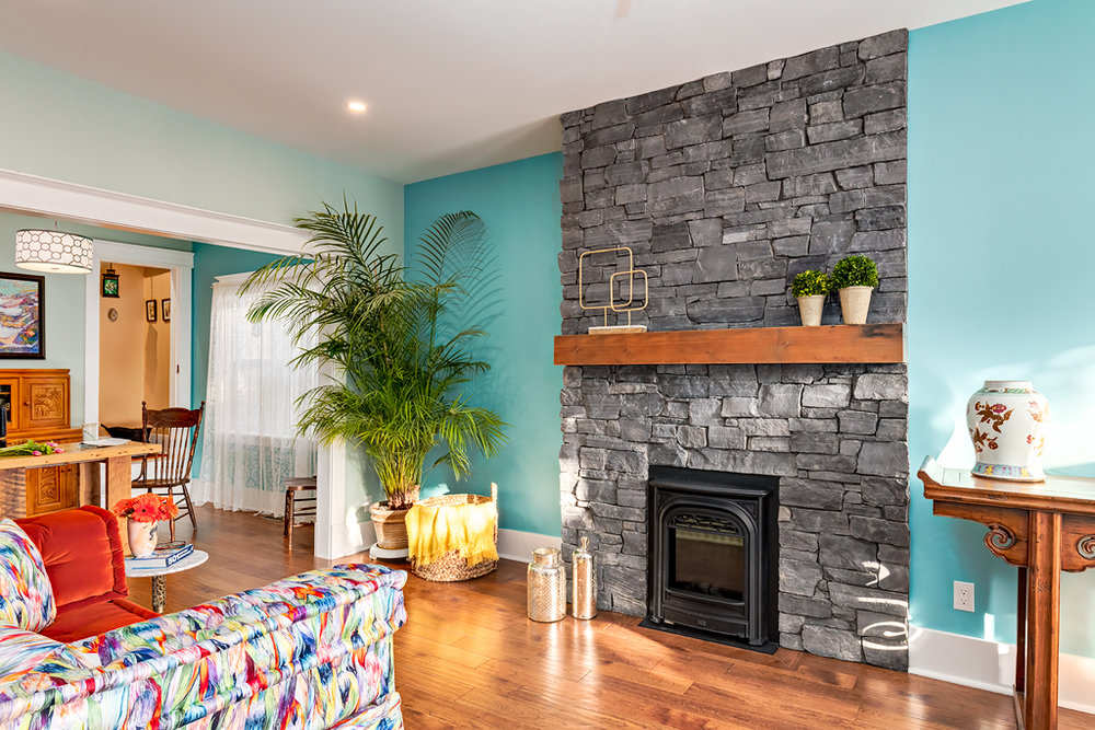 Calgary-renovation-interior-design-firplace-matle-blue-hardwood.jpg